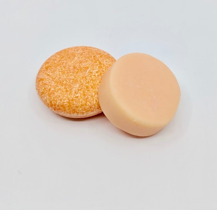 Pink Maverick brand zero waste solid shampoo and conditioner bars in tangerine and lemon scent