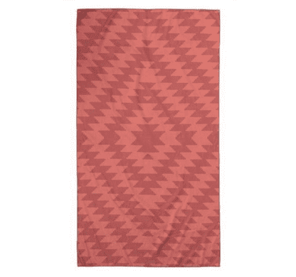 Product display of sustainable Nomadix brand, Mojave Red pattern, recycled ultralight compact travel towel.