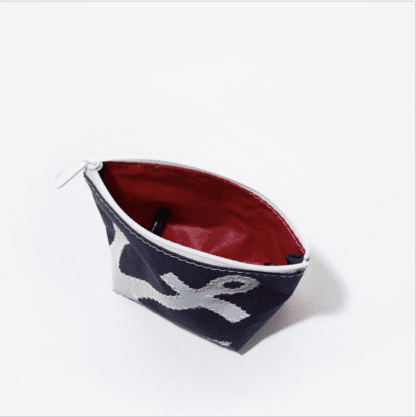Interior view of Sea Bags brand cosmetic bag with zipper and red interior liner; made from recycled sailcloth and spinnaker cloth.