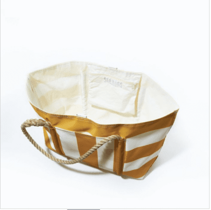 Interior of the Sea Bags brand large beach tote with white and yellow stripes; shows large exterior pocket and zippered interior pocket