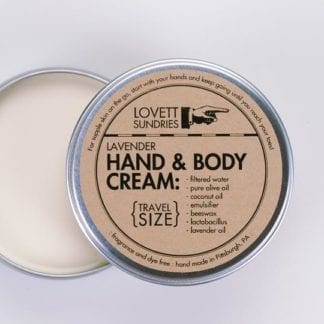 Overhead view of environmentally friendly Lovett Sundries travel size lavender scented pure oil hand cream in a reusable tin container with lid off.