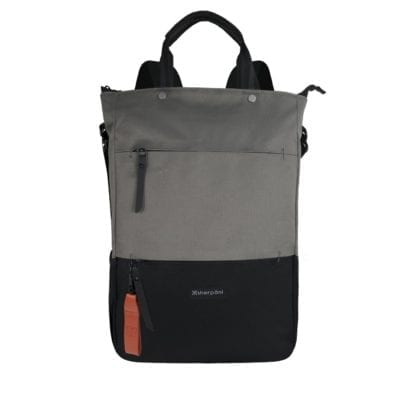 Product display of sustainable Sherpani brand Camden recycled fabric flint grey convertible backpack in purse/tote bag position with main zipper in closed position.