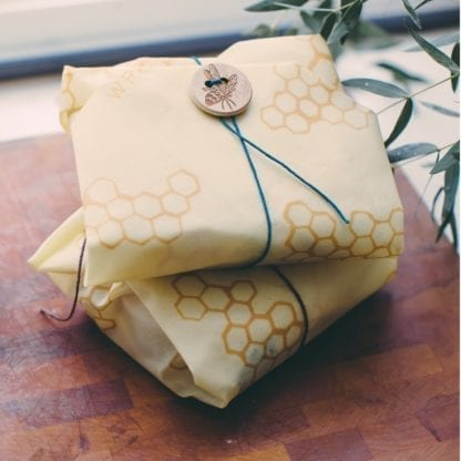 Beeswrap brand sandwich wrap with honeycomb print; use the string and bee button to secure food inside