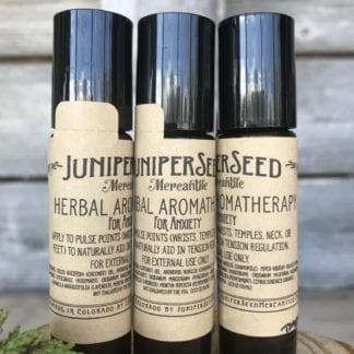 Juniperseed Mercantile brand aromatherapy oil focused to regulate stress; comes in a travel friendly glass roller container