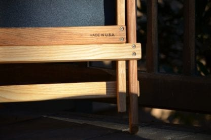 Close up display of MADE IN USA stamped on underside of eco friendly Blue Ridge Chairs brand American ash Blue Ridge forest green camping chair.