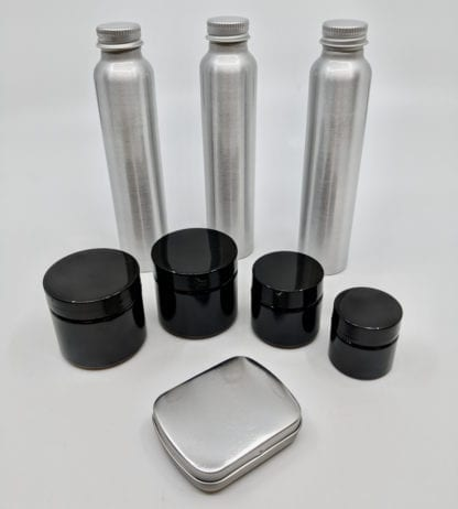 Eco friendly reusable TSA friendly tin and plastic containers, part of Reusable Pack-It Travel Container Kit.