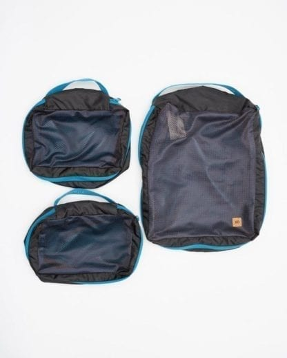 Overhead view of top side of sustainably made Ten Tree brand recycled polyester lightweight blue packing cube in closed position, with all three packing cubes displayed.