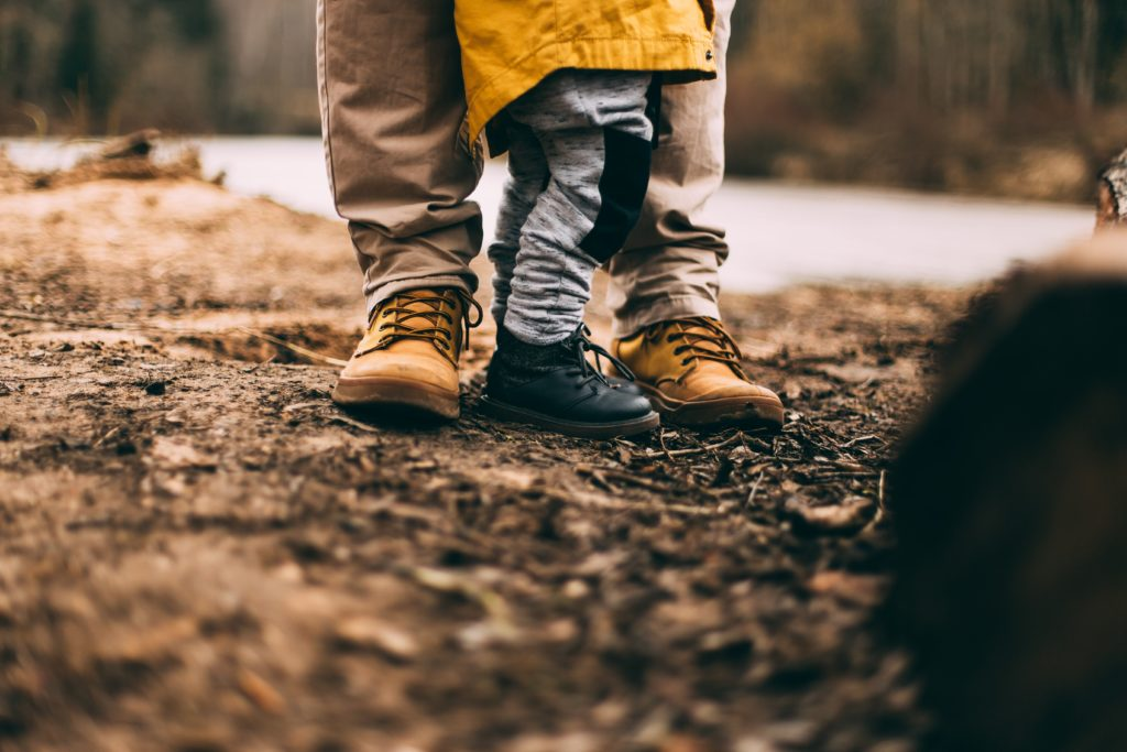 Dad standing outdoors with kid for eco-friendly fathers day gift guide